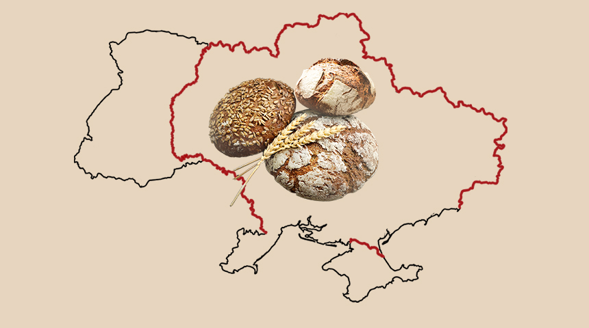 Three loafs of bread and three ears of grain with a contour of the map of Ukraine on the background